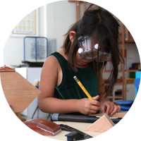 Young girl tinkering and making
